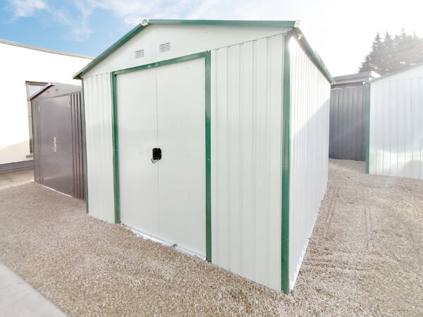 A 45 degree external view of the white-grey 9ft x 10ft steel garden shed
