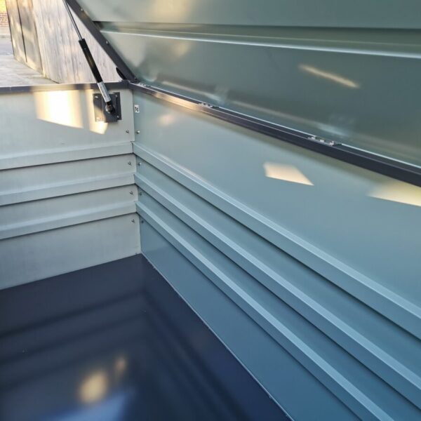 The inside of the 400L Garden Storage Box from Sheds Direct Ireland. It is grey with a three-striped interior design