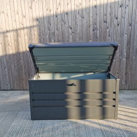 The Garden Storage Box against the wooden wall of the Sheds Direct Ireland Showroom.