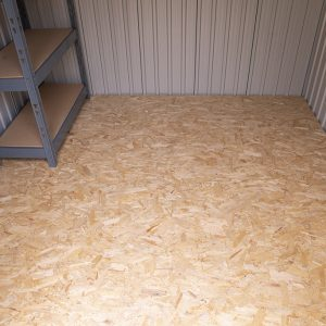 The inside of a 7.5ft x 7.5ft Steel Shed showing off the metal shelving unit
