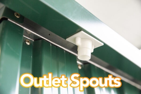 Outlet spouts attached to the gutters on this steel shed