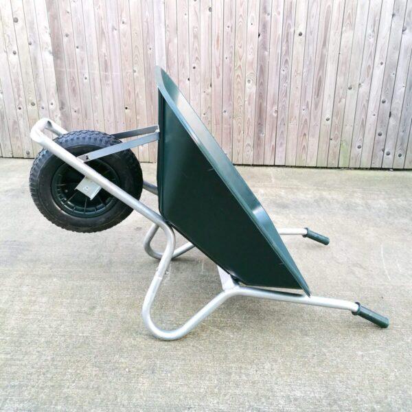 100L Wheelbarrow in a prone position, resting on it's handles