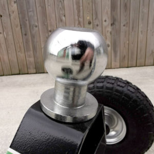 The 50mm, shiny silver ball-head attachment on the trailer dolly. It is a close up photo, with little else visible in the frame.