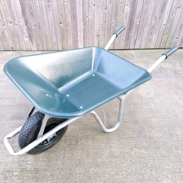 The 100L dark green wheelbarrow as seen from above. It has a silver frame and black, thick wheel