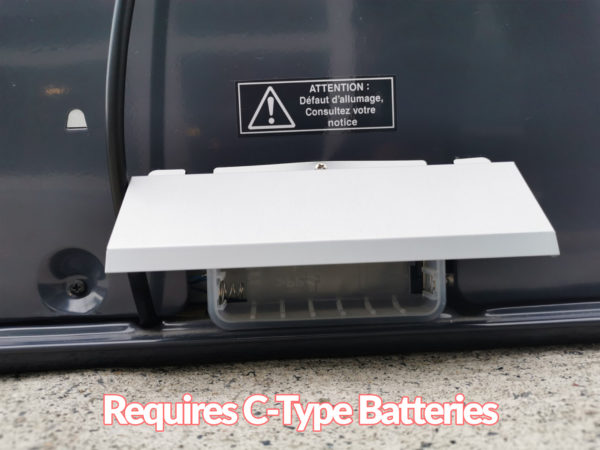 The back of the heater showing the battery insertion location. It's covered by a metallic edge. Overlaid text reads 'Requires C-Type Batteries'