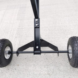 A detail of the black frame, studry screw mount and tyre-axel on the trailer dolly.