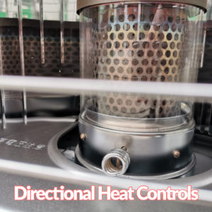 A detailed, close view of the directional heat control on the Tosai 360 / Kero 360 heater. It's curlced like a pig's tail and metallic. It's connected to the burner which is a silver, tube box with a golden, mtallic