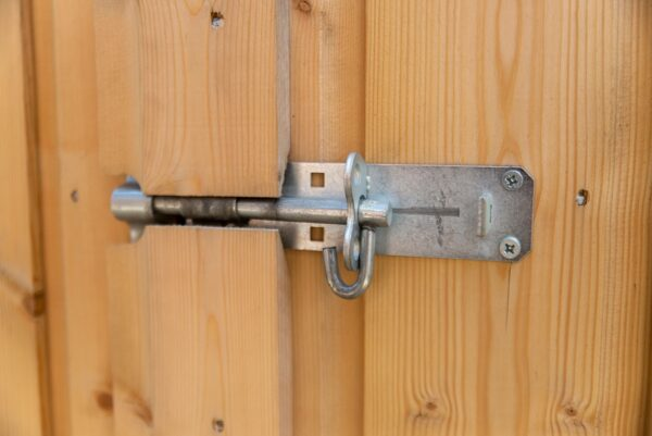 The external lock on the wooden bike store