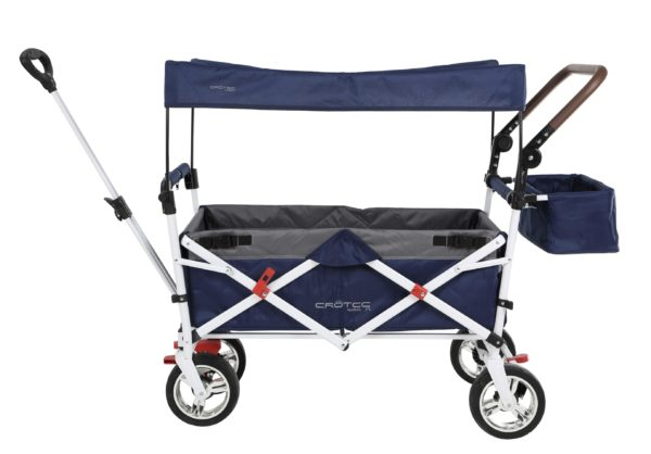The crotec pram wagon showing the sun canopy on top. it's made of the same fabric as the pram and it's supported by four white bars.