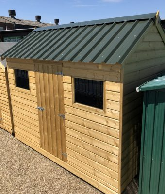 A wooded shed with a steel roof on the Sheds Direct Ireland showroom