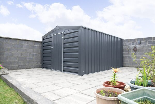 A Sheds Direct heavy duty PVC Cladded Shed in a customer's garden, against a wall with flowerpots in the foreground and a lawn to the front