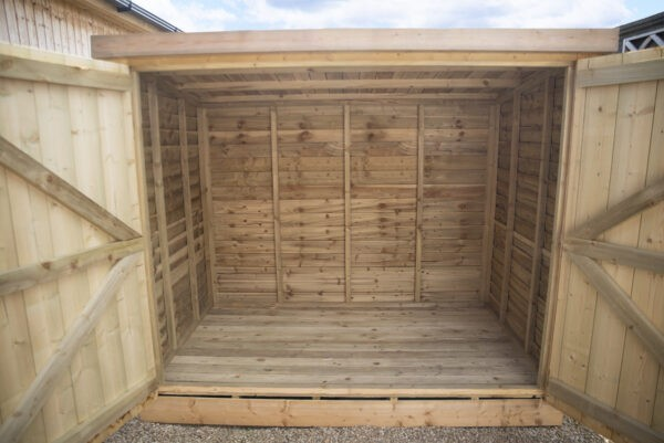 Both doors open on the wooden bike shed
