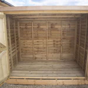 Inside of the wooden bike shed with the doors open showing the full interior and style of internal wood.
