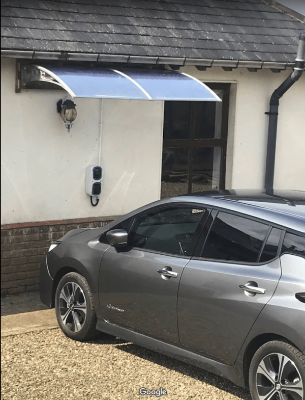 Canopy covering for electric car recharging port