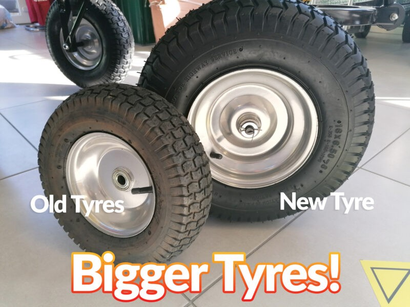 The new, bigger tyres of the 250L cart beside the old tyres. They are approximately twice the size