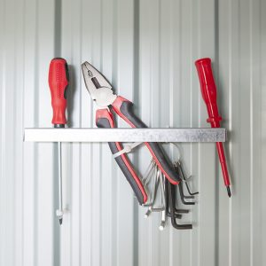 The metal hooks for holding tools in a shed alongside steel shelves from SDI 1