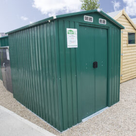 The 6ft x 8ft Steel Shed as seen from a 45 degree angle. The doors are closed and other sheds are visible surrounding.