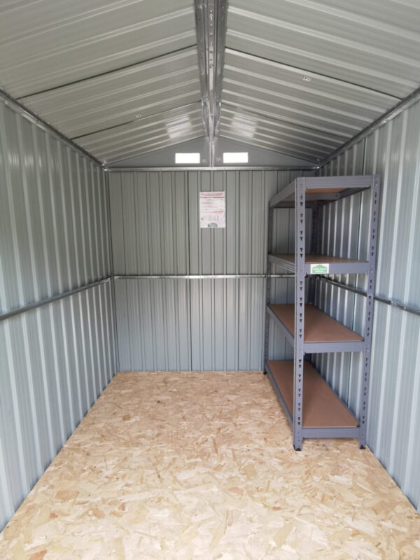 Another inside view of the 6ft x 8ft steel shed. It's taken from the doorway and the vents, metal frame, ply floor and heavy braced walls are all visible.