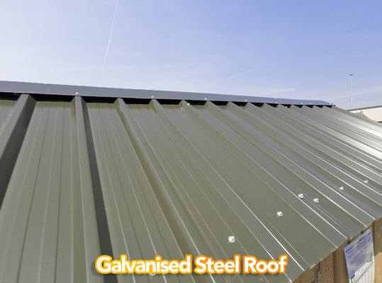 A view of the galvanised Steel Roof on a wooden sheds available from Sheds Direct Ireland. It's a deep grey-green, like a tank, and it's rivited to the walls on the outside with silver, circular bolts.