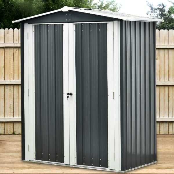 The Small shed from Sheds Direct Ireland. It is a shorter than normal shed standing on some decking against a wooden fence backdrop.