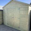 A Taller Wooden Shed - it has the door on the shorter side, the apex is above it and it's 8ft tall