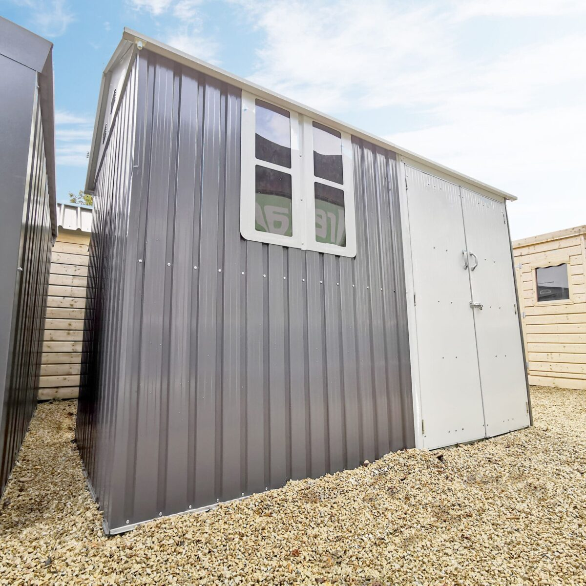 The Steel Cottage garden shed with a window on the Sheds Direct Ireland showroom