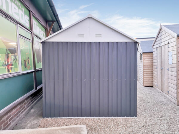 The side of the 10ft x 7.5ft steel cottage shed showing the apex to the side, the two shades of grey and the vents on the side