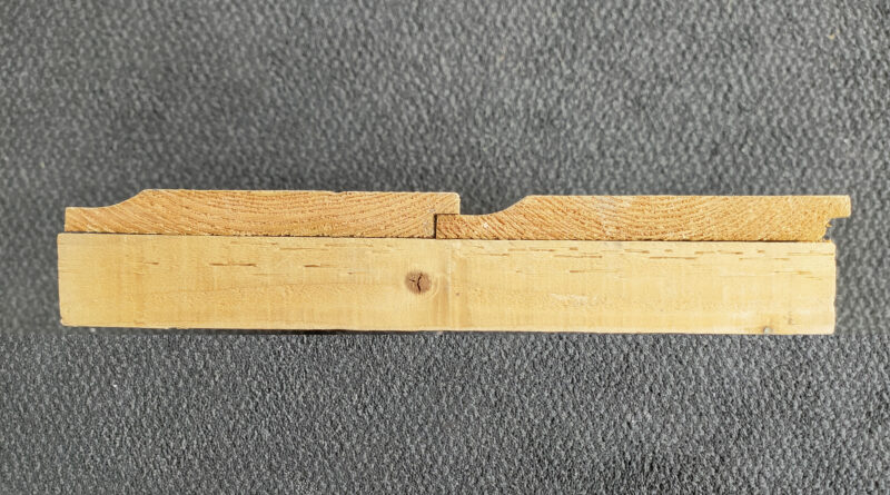 Deluxe Wood as seen on its side. If clicks in together via the 'tongue and groove' wood formation. The wood is a golden colour
