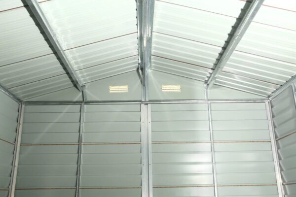 The inside of the Wood Grain Steel Sheds. It is light grey, with five internal vertical structure joists, as well as three roof supports, also in grey.