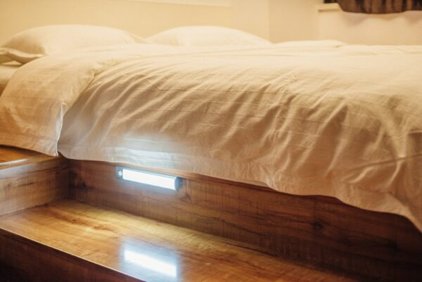 The LED light under a bed, illuminating the floor