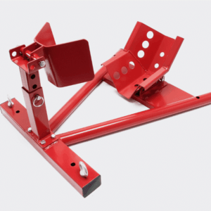 A red Motorbike Stand against a white backdrop. It has a 'V' shaped bar on which sits a cradle for the motorbike wheel. There is a support clasp opposite this to prevent the bike rolling out.