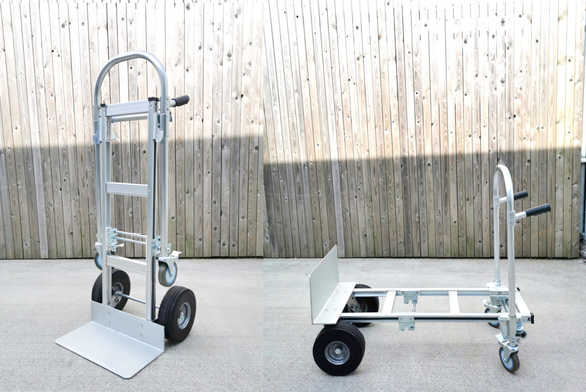 The 2 in 1 trolley seen in both it's positions. On the left it stands as a hand trolley on the right it sits as a flatbed trolley. It's silver and slightly matted with black wheels and handles.