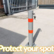 """The Parking Pole as seen from the side, with the keys hanging out of the keyhole. It reads """"Protect your spot!' underneath the image."""