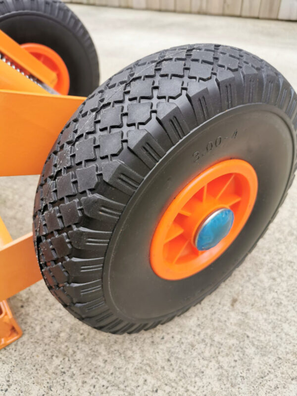 The Wheel detail on the collapsible hand trolley from Sheds Direct Ireland. It's got a bright blue cap, range coated metal and thick wheels