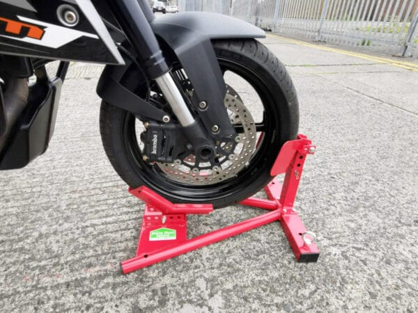 A close up of the motorbike stand in use. A motorbike wheel is raised and locked in place