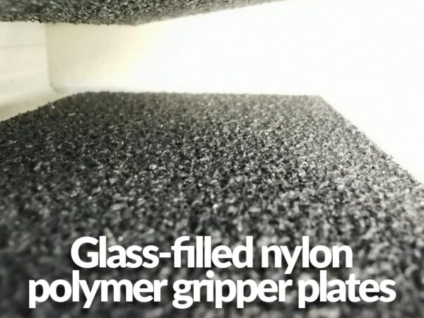A macro close up of the plates. It reads 'glass-filled nylon polymer gripper plates'