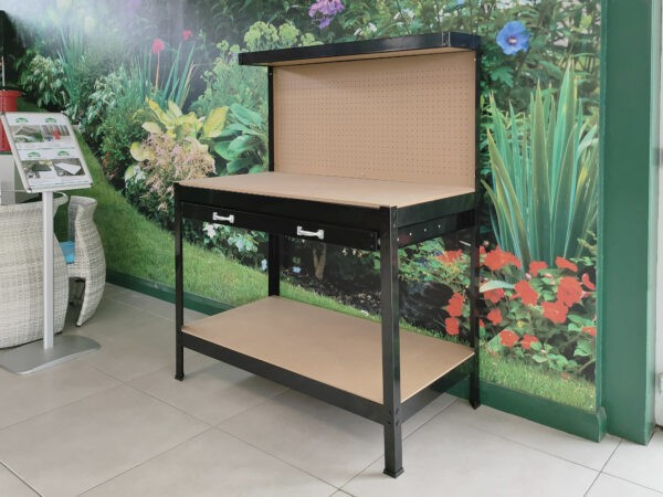 The black workbench from sheds direct ireland. It has four base legs, a low shelf, approximately 10cm off the floor. The tool drawer is 95cm off the floor and on top of this is a flat surface for working on. The back extends another 50cm up and it has holes on the backboard to attach tool hooks into.
