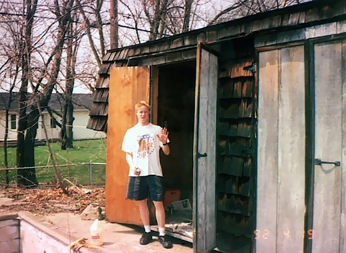 David Hahn standing outside his shed where he attempted to build a nuclear reactor
