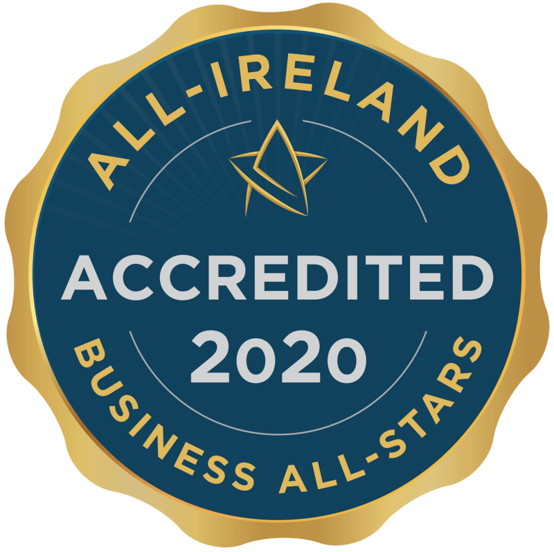 The All-Ireland Business All-Stars accreditation badge. It is a navy blue circular badge with gold trimming with an external frame like a pressed stamp. It reads 'ACCREDITED 2020' in grey text on the navy circle.