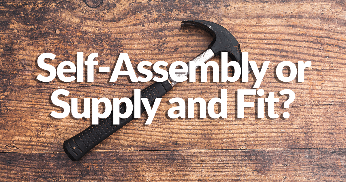 An entirely black hammer laying flat on a deep redwood backdrop with the words 'Self assembly or supply and fit?' written on top of it