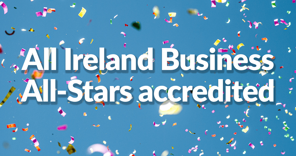 A picture of a blue background with yellow, pink, white and light-green confetti falling. On top of this is white text with a pale-grey outline that reads 'All Ireland Business All-Stars accredited'