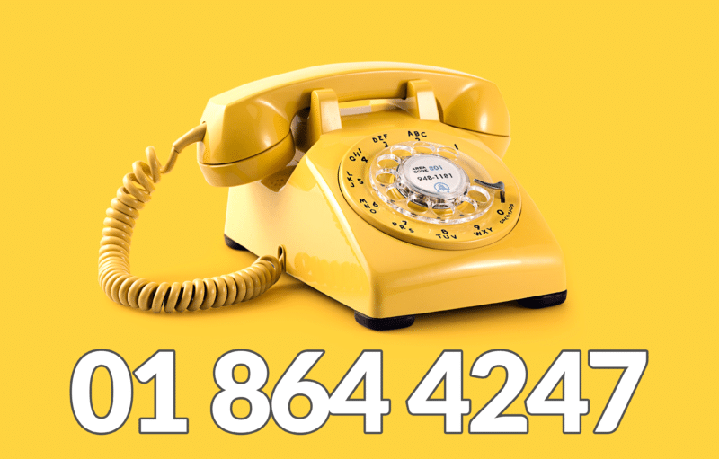 A yellow rotary phone against a yellow backdrop with the sheds direct ireland number, 01 864 4247, written on it.