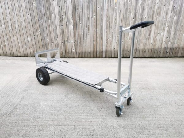 The metal backplate for the hand truck in action
