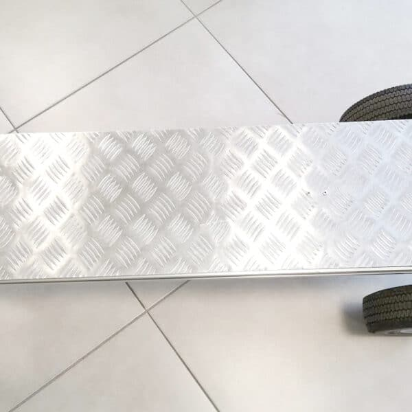 Silver backing plate for a handtruck