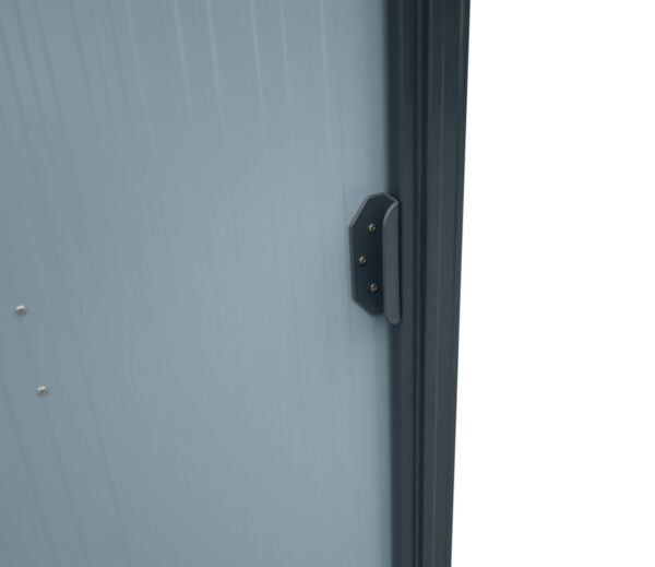 A close up of the door on the tiny shed. It's light grey with a dark grey time and dark grey handle
