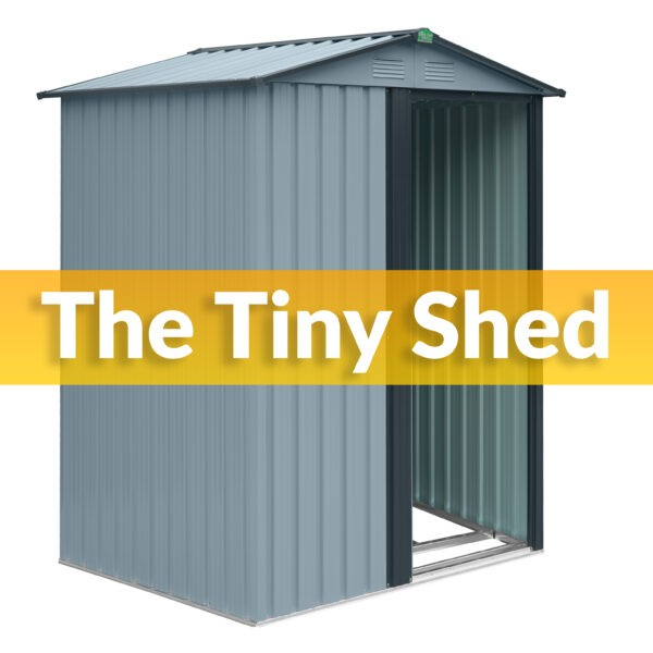 The Tiny Shed in grey against a white backdrop. It is a pale shade of grey with a darker grey trim. There is a one sliding door which is open. It reads 'THE TINY SHED' on top.