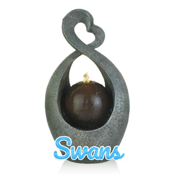 An abstract sculpture that looks like two swans whose necks are embracing to form an uneven loveheart. In the centre, a dark sphere pours water upwards in a water display