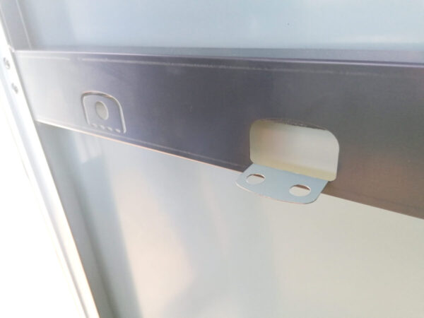 The fold-out tool hooks that are connected to the braced bars on the inside of the single-skin steel doors