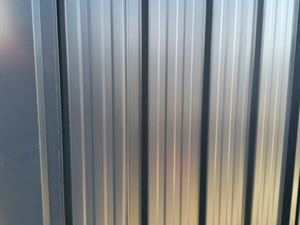 A macro shot of the sheet metal on the premium panoramic shed
