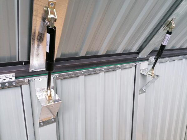 The black and silver gas hinges on the 3-bin store